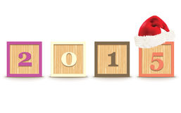 2015 gemaakt van stuk speelgoed blokken met Kerstmishoed Stock Foto