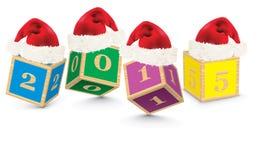2015 gemaakt van stuk speelgoed blokken met Kerstmishoeden Stock Fotografie