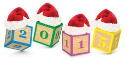 2015 gemaakt van stuk speelgoed blokken met Kerstmishoeden Royalty-vrije Stock Foto's