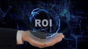 Gemalte Hand zeigt Konzepthologramm ROI auf seiner Hand lizenzfreie stockbilder