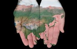 Gemalte Karte von Asien in unseren Händen Lizenzfreies Stockbild