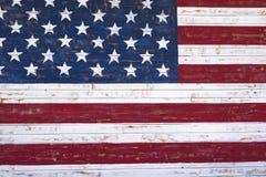 Gemalte onn der amerikanischen Flagge hölzerne Wand Lizenzfreies Stockfoto