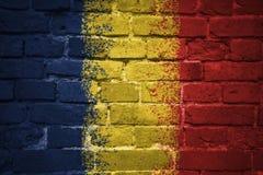 Gemalte Staatsflagge des Konfettis auf einer Backsteinmauer Stockbild