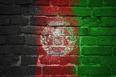 Gemalte Staatsflagge von Afghanistan auf einer Backsteinmauer Lizenzfreies Stockfoto
