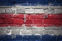 Gemalte Staatsflagge von Costa Rica auf einer Backsteinmauer Lizenzfreies Stockbild