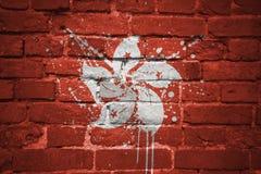 Gemalte Staatsflagge von Hong Kong auf einer Backsteinmauer Stockbilder