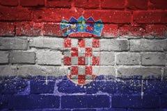 Gemalte Staatsflagge von Kroatien auf einer Backsteinmauer Lizenzfreies Stockfoto