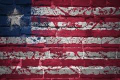 Gemalte Staatsflagge von Liberia auf einer Backsteinmauer Lizenzfreies Stockbild