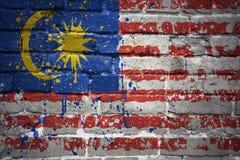 Gemalte Staatsflagge von Malaysia auf einer Backsteinmauer Stockfotografie