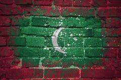 Gemalte Staatsflagge von Malediven auf einer Backsteinmauer Stockfotografie