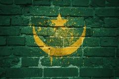 Gemalte Staatsflagge von Mauretanien auf einer Backsteinmauer Stockfoto
