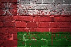 Gemalte Staatsflagge von Oman auf einer Backsteinmauer Lizenzfreies Stockfoto
