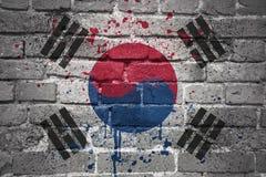 Gemalte Staatsflagge von Südkorea auf einer Backsteinmauer Lizenzfreies Stockbild