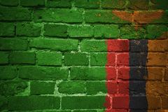 Gemalte Staatsflagge von Sambia auf einer Backsteinmauer Lizenzfreies Stockfoto