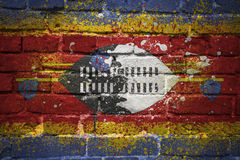 Gemalte Staatsflagge von Swasiland auf einer Backsteinmauer Lizenzfreie Stockfotografie
