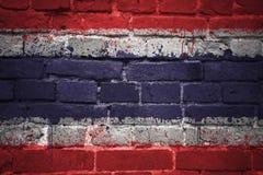 Gemalte Staatsflagge von Thailand auf einer Backsteinmauer Stockfoto