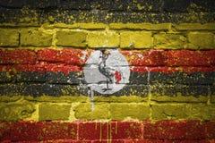 Gemalte Staatsflagge von Uganda auf einer Backsteinmauer Lizenzfreie Stockfotos
