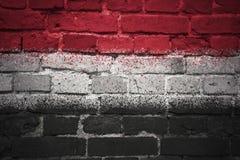 Gemalte Staatsflagge von Yemen auf einer Backsteinmauer Lizenzfreies Stockfoto