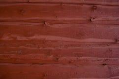 Gemalter Holzhauswandhintergrund Stockfoto
