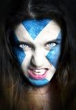 Gemaltes Gesicht mit Flagge von Schottland Stockfotografie