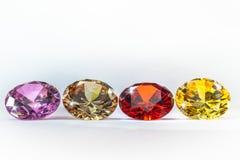 gemas coloridas en el fondo blanco Fotografía de archivo