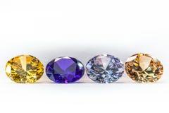 gemas coloridas en el fondo blanco Fotos de archivo libres de regalías