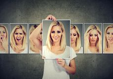 Gemaskeerde blonde jonge vrouw die verschillende emoties uitdrukken stock afbeeldingen
