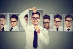 Gemaskeerde jonge mens die in glazen verschillende emoties uitdrukken royalty-vrije stock afbeelding