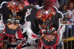 Gemaskeerde Morenada-dansers in Oruro Carnaval in Bolivië Royalty-vrije Stock Foto's