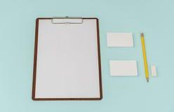 Gembräde, papper, blyertspenna och affärskort på blå bakgrund Fotografering för Bildbyråer