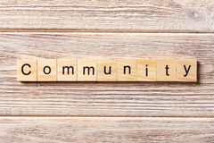 Gemeinschaftswort geschrieben auf hölzernen Block Gemeinschaftstext auf Tabelle, Konzept Lizenzfreies Stockfoto