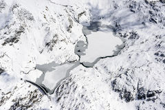 Gemelli lakes with snow and ice, Orobie, Italy Royalty Free Stock Images