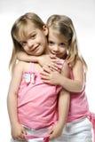 Gemelos de los niños femeninos. Imagenes de archivo