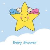 Gemelos que duermen en una estrella Imagen de archivo libre de regalías