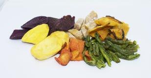 Gemengde droge vruchten groentespaanders op achtergrond royalty-vrije stock afbeelding