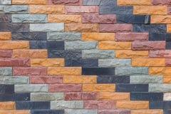Gemengde kleurenbakstenen muur, bruine, blauwe grijze, purpere patroonbackgro Stock Fotografie