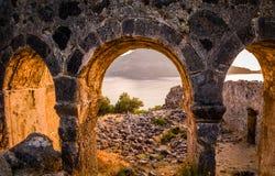 Gemiler在日落的海岛废墟 免版税库存图片