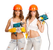 Gemini girls with an electric drill Stock Photography