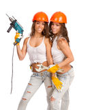 Gemini girls in orange helmets Royalty Free Stock Images
