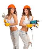 Gemini girls in orange helmets Stock Image