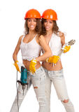 Gemini girls in orange helmets Royalty Free Stock Photos