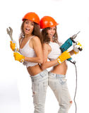 Gemini girls in orange helmets Royalty Free Stock Photo
