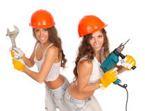 Gemini girls in orange helmets Royalty Free Stock Photography