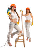 Gemini girls in orange helmets Stock Images