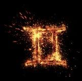 Gemini symbol spark. Is isolated on black background stock photos