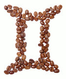 Gemini. (zodiac sign) of coffee beans isolated on white royalty free stock photo