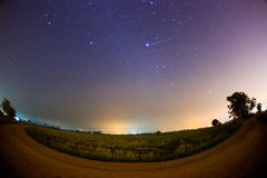 Geminid Meteor in the starry night sky. Abstract long exposure photography of Geminid Meteor in the starry night sky Royalty Free Stock Image