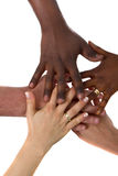 Gemischtrassige Hände zusammen Lizenzfreies Stockbild