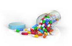 Gemorste container van kleurrijke pillen Royalty-vrije Stock Afbeelding