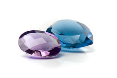 Gems. Amethyst and Aquamarine Gems on white royalty free stock photography